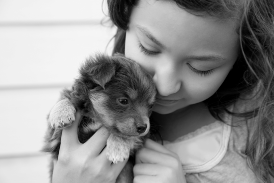 Girl embracing small dog